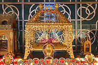 Reliquary of Saint Pierre Aumaitre, with a fragment of his femur on a pink cushion, by Cat-Berro, Orleans, surrounded by candles and gilded glass balls and set within an aluminium valance made with Arsculpt and Technical Industrie, in the Bell tower room themed 'Le Merveilleux' or The Supernatural, first floor, in Le Tresor de la Cathedral d'Angouleme, in Angouleme Cathedral, or the Cathedrale Saint-Pierre d'Angouleme, Angouleme, Charente, France. The 12th century Romanesque cathedral was largely reworked by Paul Abadie in 1852-75. In 2008, Jean-Michel Othoniel was commissioned by DRAC Aquitaine - Limousin - Poitou-Charentes to display the Treasure of the Cathedral in some of its rooms, which opened to the public on 30th September 2016. Picture by Manuel Cohen. L'autorisation de reproduire cette oeuvre doit etre demandee aupres de l'ADAGP/Permission to reproduce this work of art must be obtained from DACS.