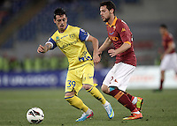 Calcio, Serie A: Roma vs Chievo Verona, Stadio Olimpico, Roma, 7 maggio  2013..ChievoVerona forward Adrian Stoian, of Romania, and AS Roma forward Mattia Destro, right, fight for the ball during the Italian serie A football match between Roma and ChievoVerona at Rome's Olympic stadium, 7 maggio  2013..UPDATE IMAGES PRESS/Isabella Bonotto
