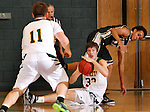 JANUARY 23, 2015 -- Riley Ryan #32 of Black Hills State tries to pass to teammate Wyatt Krogman #11 as Derrick White #14 of UC-Colorado Springs falls away during their Rocky Mountain Athletic Conference men's basketball game Friday at the Donald E. Young Center in Spearfish, S.D.  (Photo by Dick Carlson/Inertia)