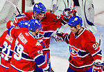 10 April 2010: Montreal Canadiens' left wing forward Benoit Pouliot (57) celebrates a first period Scott Gomez (91) goal during the last game of the regular season against the Toronto Maple Leafs at the Bell Centre in Montreal, Quebec, Canada. The Leafs defeated the Habs 4-3 in sudden death overtime as the Canadiens advance to the Stanley Cup Playoffs with the single point. Mandatory Credit: Ed Wolfstein Photo