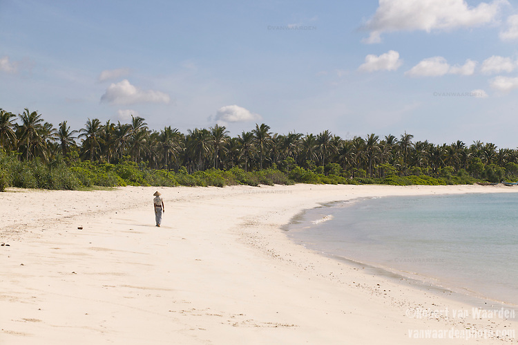 A man walks on a deserted beach near Tanjungan on the island of Lombok in Indonesia.