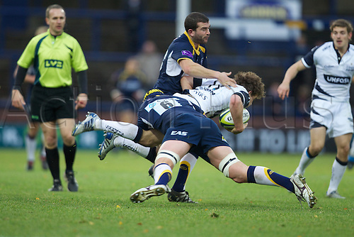 14.11.2010 LV= Cup Rugby Union. Leeds Carnegie v Sale. Sale number 11 Addison gets tackled by Leeds number 6 Rhys Oakley