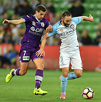 Melbourne, 23 April 2017 - JOEL CHIANESE (7) of the Glory and JOSHUA ROSE (3) of Melbourne City compete for the ball in the Elimination Final 2 of the A-League between Melbourne City and Perth Glory at AAMI Park, Melbourne, Australia. Perth won 2-0. Photo Sydney Low/sydlow.com