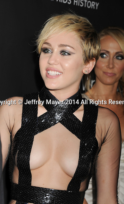 HOLLYWOOD, CA- OCTOBER 29: Recording artist Miley Cyrus  attends amfAR LA Inspiration Gala honoring Tom Ford at Milk Studios on October 29, 2014 in Hollywood, California.