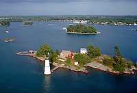 A lighthouse on one of New York's Thousand Islands in the St. Lawrence Seaway as it empties into Lake Ontario. New York USA Thousand Islands.