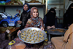 A Palestinian girl makes traditional date-filled cookies with her family in preparation for the Eid al-Fitr holiday at their home in Rafah, in the southern Gaza Strip, on June 23, 2017. Muslims around the world are preparing to celebrate the Eid al-Fitr holiday, which marks the end of the fasting month of Ramadan. Photo by Abed Rahim Khatib