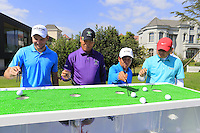 Max Kieffer (GER) and team try the chopsticks challenge during Tuesday's Pro-Am Day of the 2014 BMW Masters held at Lake Malaren, Shanghai, China 28th October 2014.<br /> Picture: Eoin Clarke www.golffile.ie