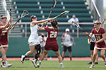 RICHMOND, VA - APRIL 27: Notre Dame's Heidi Annaheim (14) shoots over Boston College's Brooke Troy (28) and Boston College's Dempsey Arsenault (18). The Notre Dame Fighting Irish played the Boston College Eagles on April 27, 2017, at Sports Backers Stadium in Richmond, VA in an ACC Women's Lacrosse Tournament quarterfinal match. Boston College won the game 17-14.