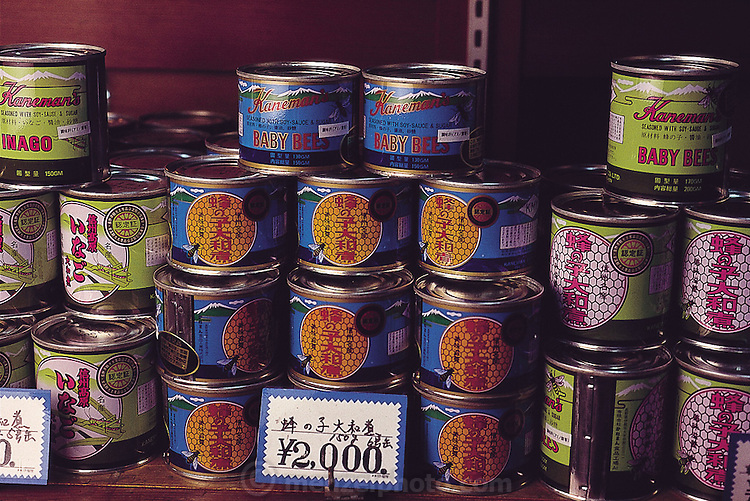 Cans of baby bees and grasshoppers (inago) sold by the Kaneman Company, Ina City, Japan. (Man Eating Bugs page 31 Inset)