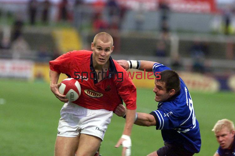 Matt Cardey avoids the tackle of Chris Ferris.Llanelli v Bridgend.01.09.01.©Steve Pope.Sportingwales.com.07798 83 00 89.124 Duckpool Road.Newport South Wales.NP19 8FL