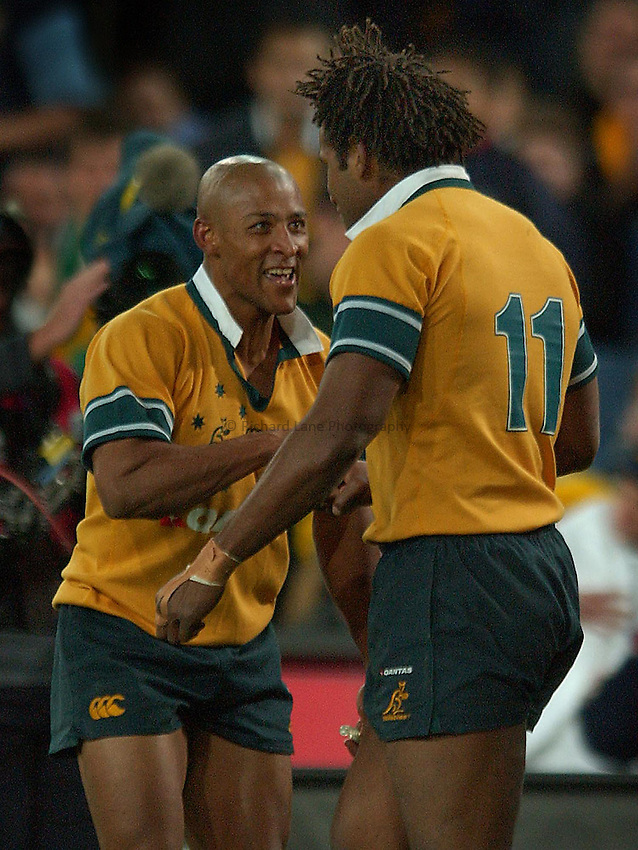 PICS: JACK ATLEY..AUSTRALIA V SCOTLAND RUGBY UNION at SYDNEY STADIUM, SYDNEY, AUSTRALIA. 20/06/2004..Australian captain George Gregan celebrates Lote Tuqiri try