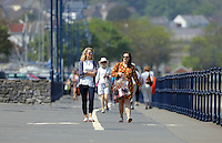 Two young women enjoy a stroll in the sunshine by Mumbles in Swansea, Wales, UK Friday 13 May 2016