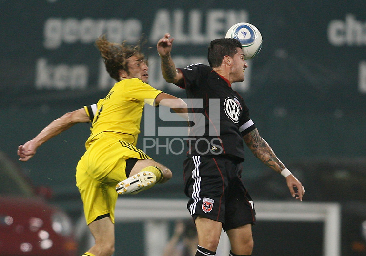 Santino Quaranta #25 of D.C. United heads away from Frankie Hejduk #2 of the Columbus Crew during a US Open Cup semi final match at RFK Stadium on September 1 2010, in Washington DC. Columbus won 2-1 aet.