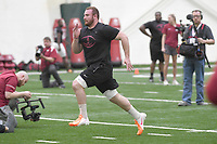 NWA Democrat-Gazette/J.T. WAMPLER  Frank Ragnow runs for scouts and coaches Monday March 26, 2018 at the Walker Pavilion at the University of Arkansas. Former players had a chance to demonstrate their skills ahead of  the NFL Draft and free agency signings.