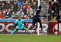 Pictured L-R: Michel Vorm of Swansea stops a shot by Emmanuel Adebayor of Tottenham (R).  Saturday 30 March 2013<br /> Re: Barclay's Premier League, Swansea City FC v Tottenham Hotspur at the Liberty Stadium, south Wales.