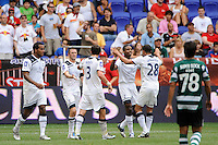 Jonathan Obika (34) of Tottenham Hotspur F. C. celebrates scoring with Kyle Walker (28). Tottenham Hotspur F. C. and Sporting Clube de Portugal played to a 2-2 tie during a Barclays New York Challenge match at Red Bull Arena in Harrison, NJ, on July 25, 2010.