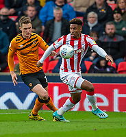 7th March 2020; Bet365 Stadium, Stoke, Staffordshire, England; English Championship Football, Stoke City versus Hull City; Tyrese Campbell of Stoke City under pressure from Sean McLoughlin of Hull City