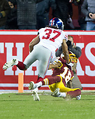 New York Giants defensive back Ross Cockrell (37) on a play where he will be called for pass interference while defending Washington Redskins wide receiver Josh Doctson (18) in second quarter action at FedEx Field in Landover, Maryland on Thursday, November 23, 2017.<br /> Credit: Ron Sachs / CNP<br /> (RESTRICTION: NO New York or New Jersey Newspapers or newspapers within a 75 mile radius of New York City)