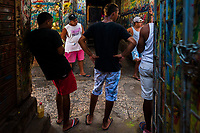 """Colombian sign painters hang out in the sign painting workshop in Cartagena, Colombia, 12 December 2017. Hidden in the dark, narrow alleys of Bazurto market, a group of dozen young men gathered around José Corredor (""""Runner""""), the master painter, produce every day hundreds of hand-painted posters. Although the vast majority of the production is designed for a cheap visual promotion of popular Champeta music parties, held every weekend around the city, Runner and his apprentices also create other graphic design artworks, based on brush lettering technique. Using simple brushes and bright paints, the artisanal workshop keeps the traditional sign painting art alive."""