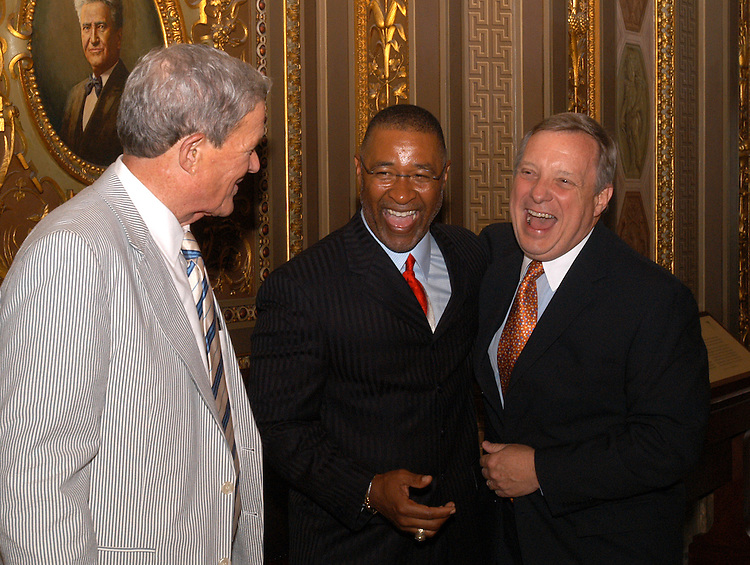 ozzie1/071003  - Baseball Hall of Famer Ozzie Smith talks with Sen. Dick Durbin, D-Ill., and Sen. Kit Bond, R-Mo.