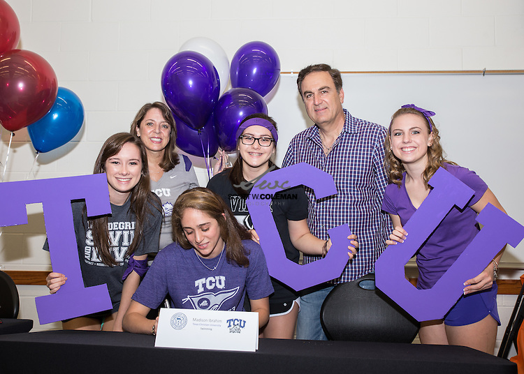Madison Ibrahim signs a letter of intent to attend Texas Christian University for swimming, at Vandegrift High School's signing ceremony on April 23, 2015.