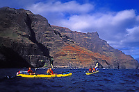 EDITORIAL ONLY. Kayaking the rugged Na Pali coast to Kalalau Valley, north shore, Kauai
