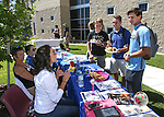 Connor Johnson, Spencer Rogers and Brandon Gagnon talk with Katharyn Kurek, with the National Student Nursing Association, at a student BBQ and club fair at Western Nevada College in Carson City, Nev., on Thursday, Sept. 1, 2016. <br />Photo by Cathleen Allison