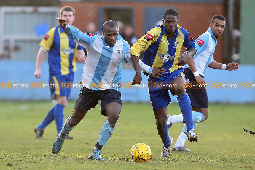 Ryan Edgar of Brentwood tangles with Abs Seymour of Romford - Brentwood Town vs Romford - Ryman League Division One North Football at the Brentwood Centre - 22/01/11 - MANDATORY CREDIT: Gavin Ellis/TGSPHOTO - Self billing applies where appropriate - Tel: 0845 094 6026