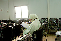 A woman reads during a multimedia lecture by Dr Manal Abul Hassan, in FJP headquarters in Downtown, Cairo. Egypt, October 2012.<br /> (assignment for the Financial Times)