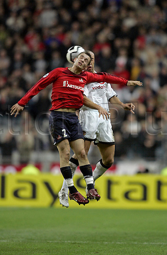 2 November 2005: Lille midfielder Mathieu Debuchy competes with Mikael Silvestre to head the ball during the UEFA Champions League group D game between Lille and Manchester United played at the Stade de France, Paris. Lille won the match 1-0. Photo: Neil Tingle/Actionplus<br /> <br /> 051102 football soccer player footballer header heading