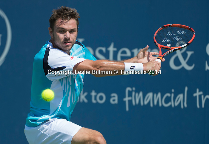 Stanislas Wawrinka (SUI) loses in three sets to Juliwn Benneteau (FRA) 6-1, 1-6, 6-2 at the Western & Southern Open in Mason, OH on August 15, 2014.