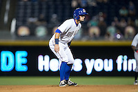 Joey Rickard (4) of the Durham Bulls takes his lead off of second base against the Indianapolis Indians at Durham Bulls Athletic Park on August 4, 2015 in Durham, North Carolina.  The Indians defeated the Bulls 5-1.  (Brian Westerholt/Four Seam Images)