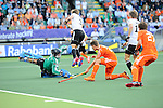 The Hague, Netherlands, June 06: Nicolas Jacobi #1 of Germany and Linus Butt #3 of Germany defends during the match during the field hockey group match (Men - Group B) between Germany and The Netherlands on June 6, 2014 during the World Cup 2014 at Kyocera Stadium in The Hague, Netherlands. Final score 0-1 (0-1) (Photo by Dirk Markgraf / www.265-images.com) *** Local caption *** Nicolas Jacobi #1 of Germany, Linus Butt #3 of Germany, Jelle Galema #20 of The Netherlands, Benjamin Weiss #15 of Germany