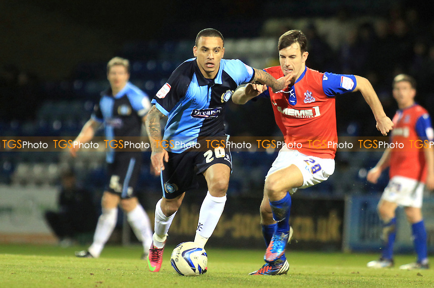 Wycombe's Dean Morgan tries to shake off a challenge from Steven Gregory of Gillingham - Gillingham vs Wycombe Wanderers - NPower League Two Football at Priestfield Stadium, Gillingham, Kent - 04/02/13 - MANDATORY CREDIT: Paul Dennis/TGSPHOTO - Self billing applies where appropriate - 0845 094 6026 - contact@tgsphoto.co.uk - NO UNPAID USE.