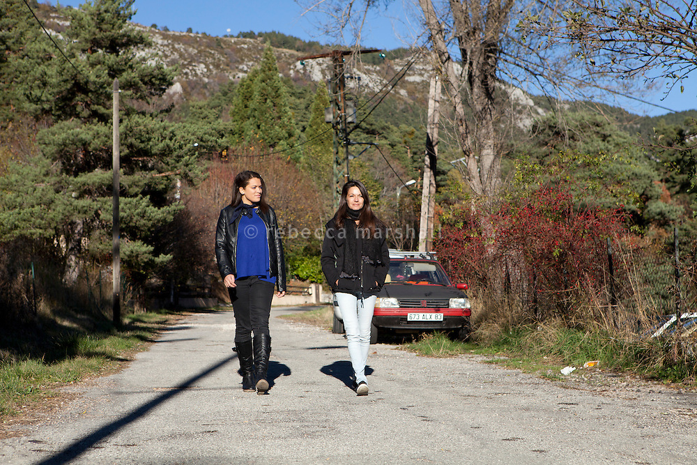 Manon Serrano (left) and her mother Sophie walk together down the road on which their apartment block is situated, Thorenc, Alpes-Maritimes, France, 11 November 2013