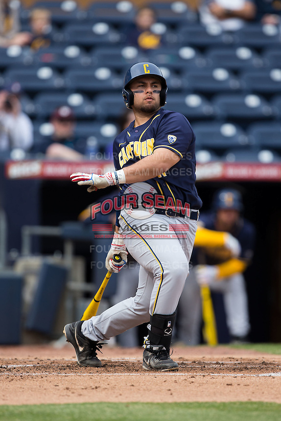 Brenden Farney (21) of the California Golden Bears follows through on his swing against the Duke Blue Devils at Durham Bulls Athletic Park on February 20, 2016 in Durham, North Carolina.  The Blue Devils defeated the Golden Bears 6-5 in 10 innings.  (Brian Westerholt/Four Seam Images)