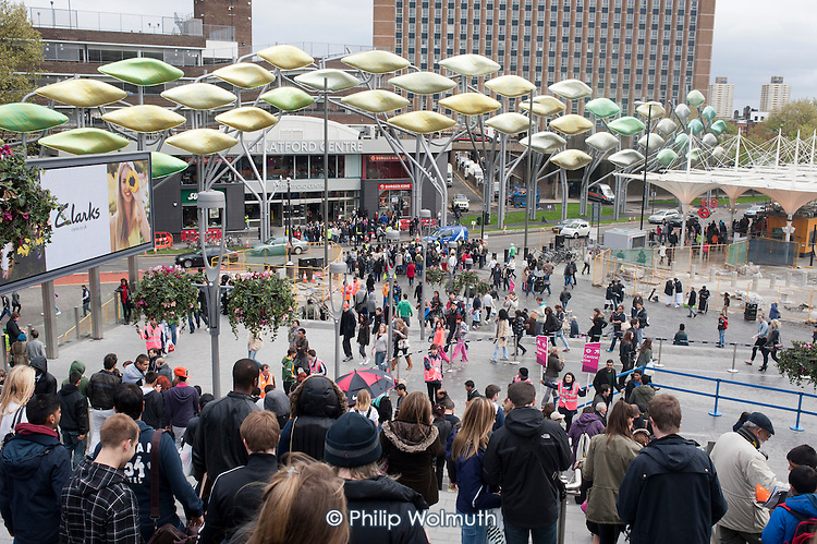 Crowds pass through the Stratford Centre on the day of the formal opening of the London 2012 Olympic Stadium.