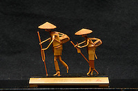 "Pilgrim figures by Takashi Fujita, ""Awatake Ningyo"" bamboo figure artist, Naruto, Tokushima Prefecture, Japan, July 8, 2014. The city of Naruto in Tokushima Japan is famous for whirlpools that form in the Naruto Strait. It is home to Otani pottery and the first two temples on the Shikoku 88 temple pilgrimage."
