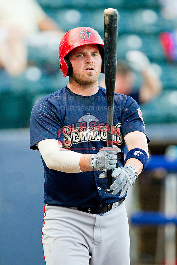 Derek Norris #25 of the Harrisburg Senators checks his bat before stepping up to the plate against the Richmond Flying Squirrels in game one of a double-header at The Diamond on July 22, 2011 in Richmond, Virginia.  The Squirrels defeated the Senators 3-1.   (Brian Westerholt / Four Seam Images)