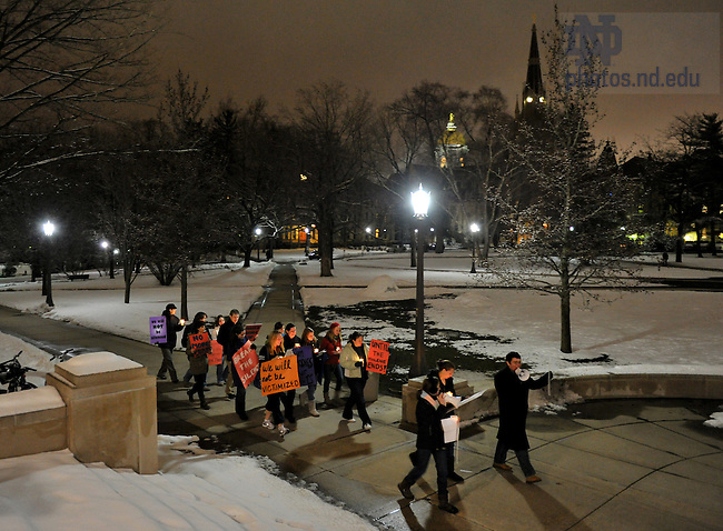 """Students walk campus on the """"Take Back the Night"""" march as part of sexual assault awareness week...Photo by Matt Cashore/University of Notre Dame"""