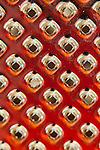 Creative red and orange abstract of cheese grater holes