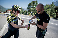 on their way to the bottle point, the Mitchelton-Scott crew bounce into Annemiek van Vleuten (NED/Mitchelton-Scott) who is training in the neighbourhood <br /> <br /> Stage 18: Embrun to Valloire(208km)<br /> 106th Tour de France 2019 (2.UWT)<br /> <br /> ©kramon