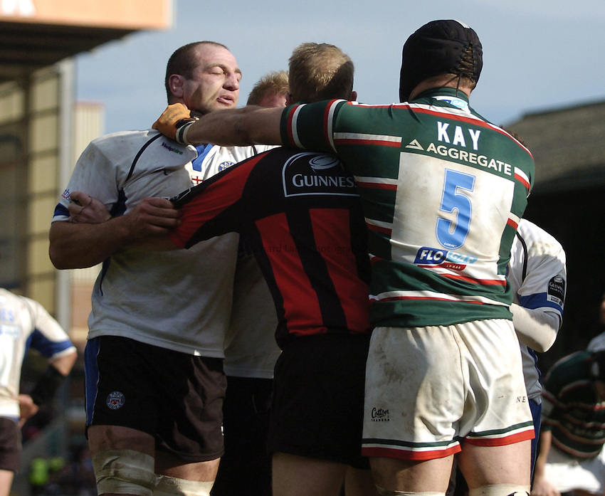 Photo: Jonathan Butler..Leicester Tigers v Bath Rugby. Guinness Premiership. 17/03/2007..Referee Wayne Barnes has to separate a fight between Steve Borthwick of Bath and Ben Kay of Leicester