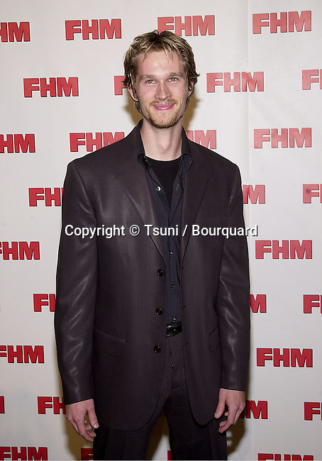 Alex Martin arriving at The magazine FHM salutes the 100 sexist women of the world at La Boheme cafe in Los Angeles 5/17/2001  © Tsuni          -            MartinAlex01.jpg