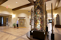 NWA Democrat-Gazette/DAVID GOTTSCHALK Stained glass panels from the chapel previous St. Scholastica Monastery are on display Thursday, May 9, 2019, in the new St. Scholastica Monastery in Fort Smith. The nuns of St. Scholastica Monastery moved in January from their very large almost century-old building into a smaller convent. They are selling hundreds of items at auction beginning Thursday.