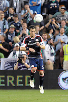 AJ Soares New England defender heads the ball... Sporting Kansas City defeated New England Revolution 3-0 at LIVESTRONG Sporting Park, Kansas City, Kansas.