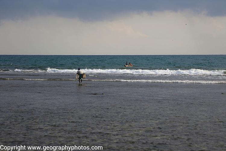 People fishing on offshore coral reef, Pasikudah Bay, Eastern Province, Sri Lanka, Asia