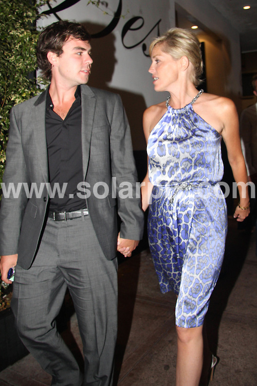 **ALL ROUND PICTURES FROM SOLARPIX.COM**.**WORLDWIDE SYNDICATION RIGHTS**.**NO PUBLICATION IN AUSTRALIA, DENMARK, GERMANY, NEW ZEALAND, RUSSIA, UK OR USA**.The Hollywood actress Sharon Stone and her boyfriend have a late night dinner at Beso Restaurant in Hollywood Los Angeles California in the USA..This pic:Sharon Stone,Boyfriend ..JOB REF: 7096-LAP/HG       DATE:23_08_08 .**MUST CREDIT SOLARPIX.COM OR DOUBLE FEE WILL BE CHARGED* *UNDER NO CIRCUMSTANCES IS THIS IMAGE TO BE REPRODUCED FOR ANY ONLINE EDITION WITHOUT PRIOR PERMISSION*
