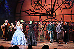 Alli Mauzey and Lindsay Mendez with cast during the 10th Anniversary on Broadway Curtain Call for 'Wicked'  at the Gershwin Theatre on October 30, 2013  in New York City.