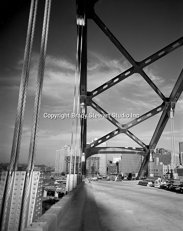 Pittsburgh PA:  A view of Hilton Hotel and Fort Pitt Bridge Construction from the Fort Pitt Bridge - 1959